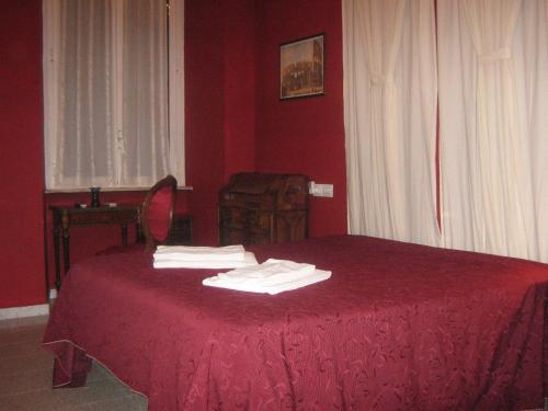 Кровать или кровати в номере Hotel Ferraro