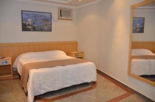 A bed or beds in a room at Saionara Hotel