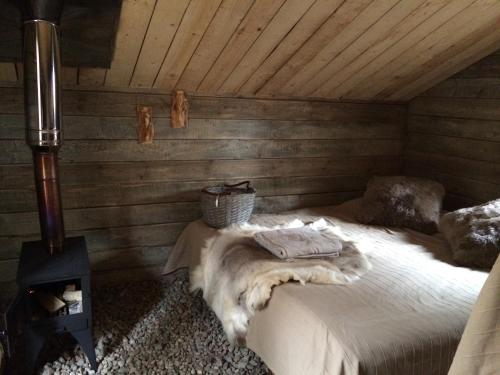 Кровать или кровати в номере Эко-Отель Лес