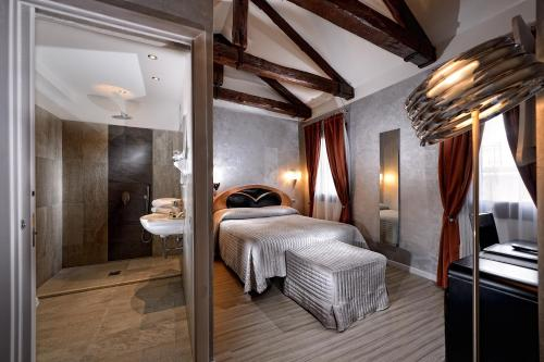 Cama ou camas em um quarto em Hotel Paganelli