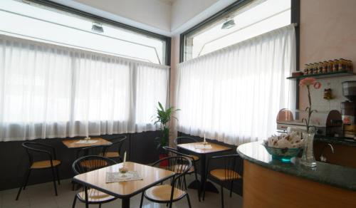 A restaurant or other place to eat at Hotel Cecile