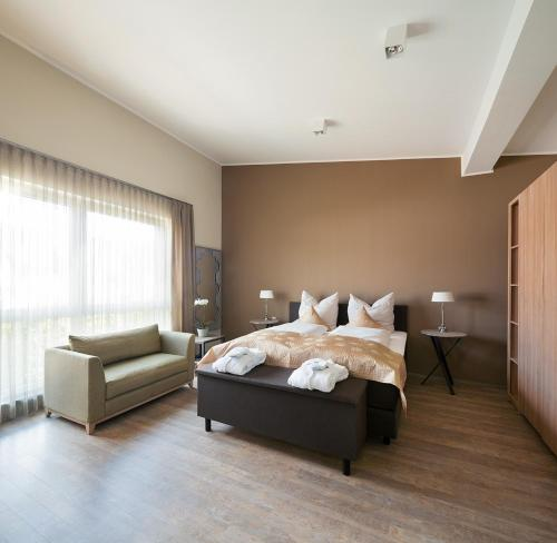 A bed or beds in a room at Boarding Haus Aachen-Brand