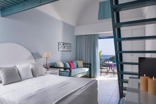 A bed or beds in a room at Veggera Beach Hotel