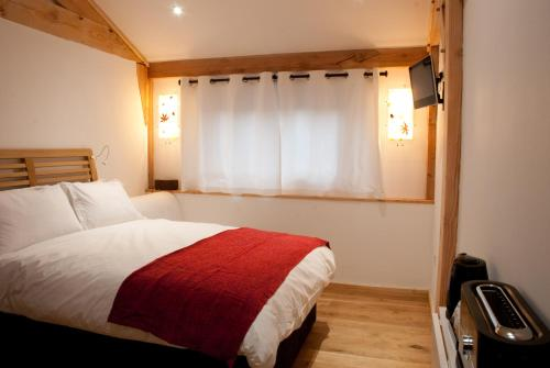 A bed or beds in a room at Bull Farm Studios