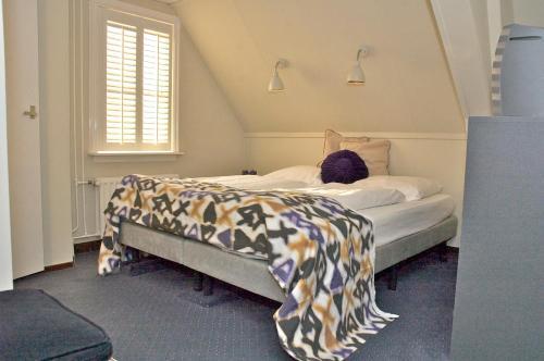 Un ou plusieurs lits dans un hébergement de l'établissement De Herberg