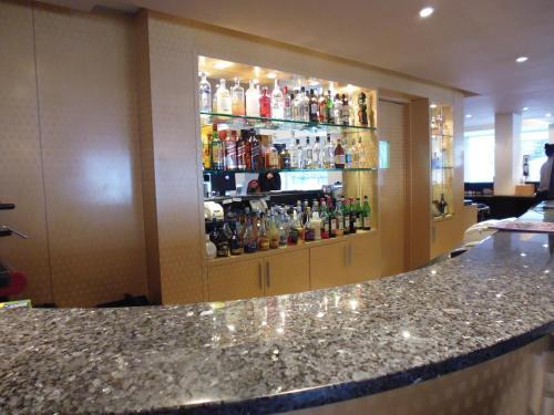 The lounge or bar area at Fueguino Hotel