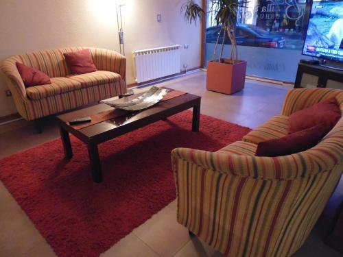 A seating area at Hotel Villa Brescia