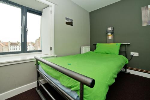 A bed or beds in a room at YHA Berwick