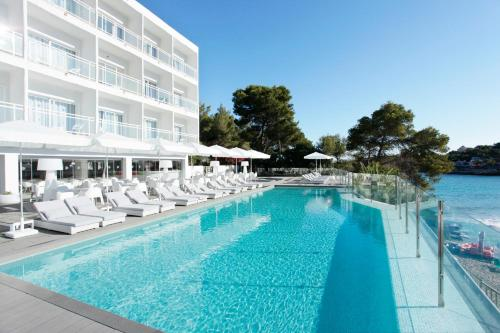 The swimming pool at or close to Grupotel Ibiza Beach Resort - Adults Only