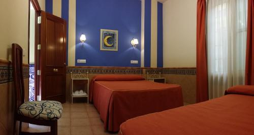 Cama o camas de una habitación en Pension Doña Trinidad