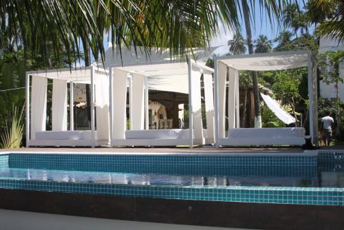 The swimming pool at or close to Praiagogi Boutique Pousada