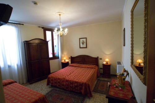 Letto o letti in una camera di Hotel Tivoli