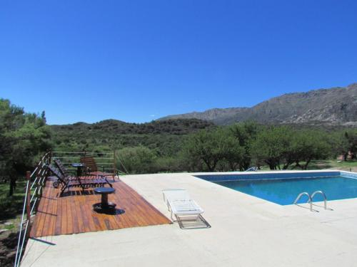 The swimming pool at or near Cabañas de Montaña San Miguel