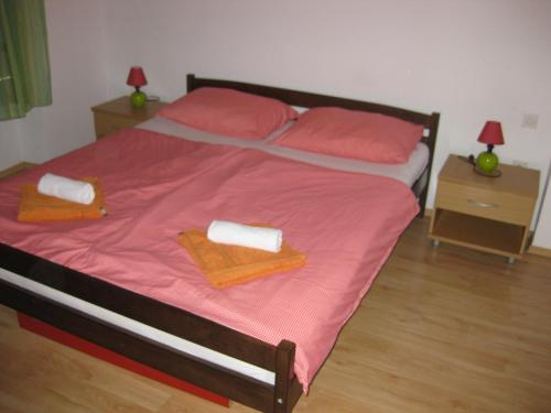 A bed or beds in a room at Apartment Roby