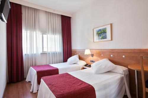 A bed or beds in a room at Acta Antibes