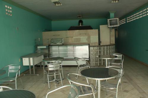 Una cocina o zona de cocina en Hotel Magnifico