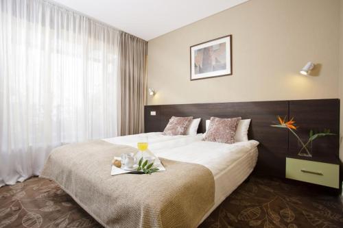 Кровать или кровати в номере Hotel Babilonas