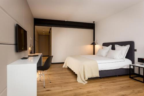 A bed or beds in a room at Sense Hotel Sofia