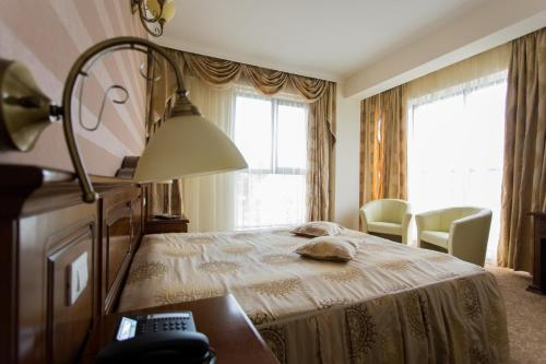 A bed or beds in a room at President Hotel