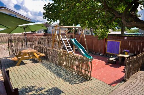 Children's play area at Veldzes Nams