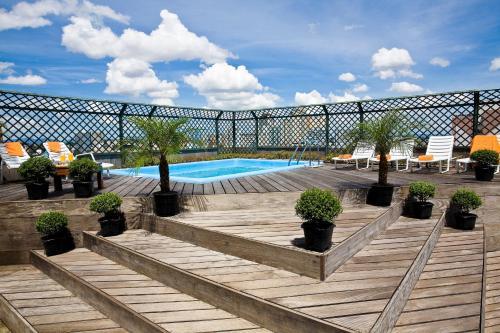 The swimming pool at or near Alta Reggia Plaza Hotel