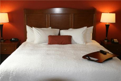 A bed or beds in a room at Hampton Inn & Suites Bastrop