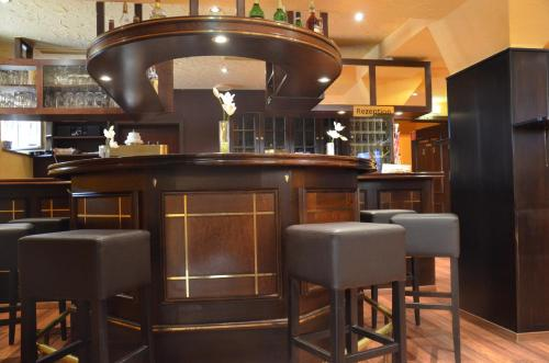 The lounge or bar area at Hotel am Wilhelmsplatz