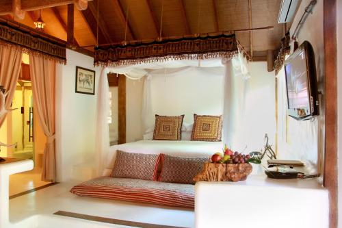 A bed or beds in a room at Pai Island Resort