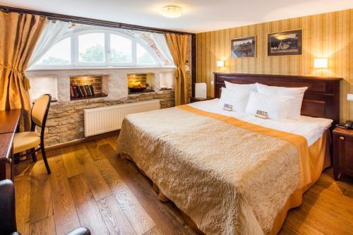 Vuode tai vuoteita majoituspaikassa The von Stackelberg Hotel Tallinn