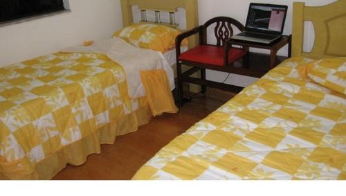 A bed or beds in a room at Apartamento Guarulhos