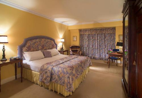 A bed or beds in a room at Aherne's Townhouse Hotel and Seafood Restaurant