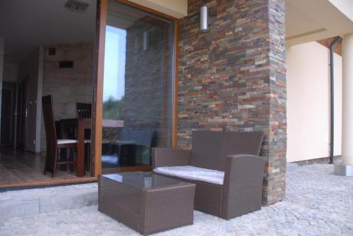 Patio lub wspólna przestrzeń na świeżym powietrzu w obiekcie Apartament Ostoja