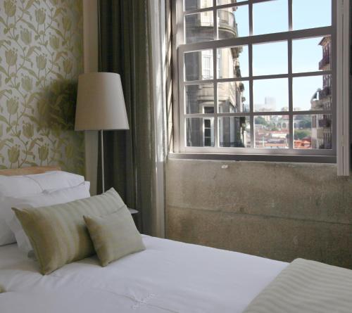 Uma cama ou camas num quarto em Sao Domingos by Oporto Tourist Apartments