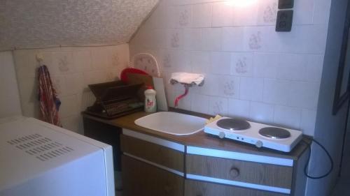 A bathroom at Póczáné Vendégszobái