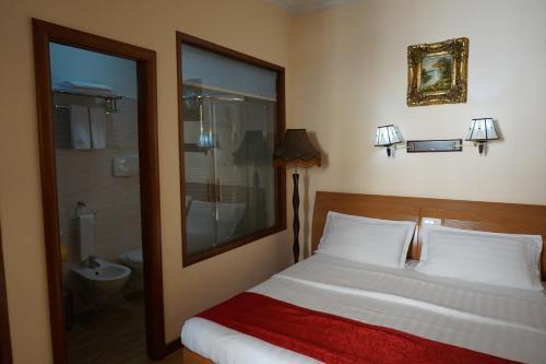 Un ou plusieurs lits dans un hébergement de l'établissement Hotel Filippo