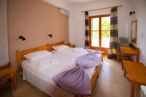Кровать или кровати в номере Marie Hotel