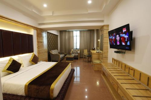 A television and/or entertainment center at Hotel Saffron Leaf