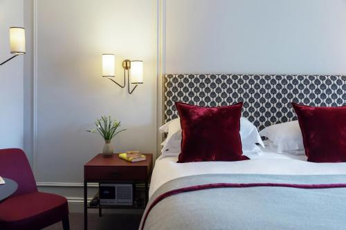 A bed or beds in a room at Old Parsonage Hotel