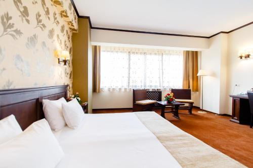 A bed or beds in a room at International Bucharest City Centre Hotel