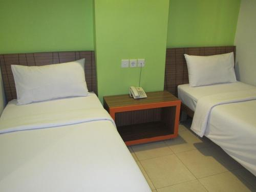 A bed or beds in a room at Studio One