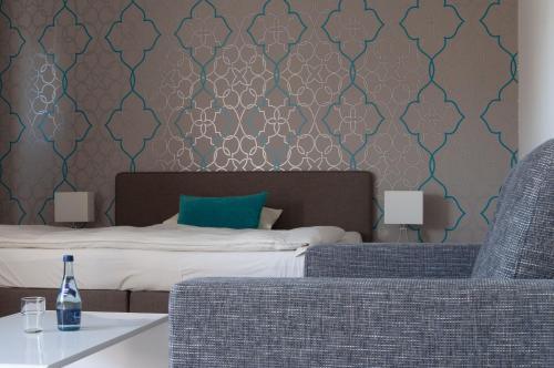 Кровать или кровати в номере Hotel Insel Pension