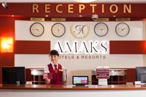 Лобби или стойка регистрации в AMAKS City-Hotel