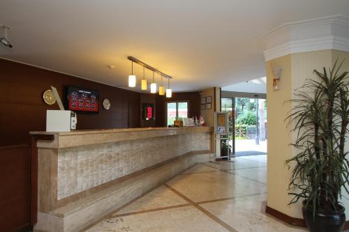 De lobby of receptie bij Club Aida