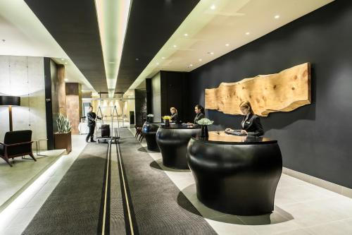 The lobby or reception area at Movich Buró 26