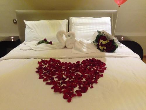 Cama ou camas em um quarto em Quiet Dreams - Al Murjan Branch