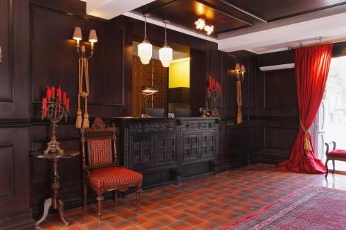 The lobby or reception area at Hotel Boutique Castillo Rojo