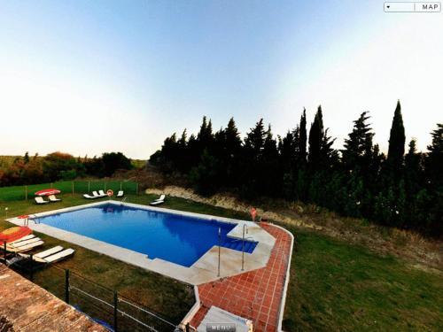 The swimming pool at or near El Palomar de la Breña