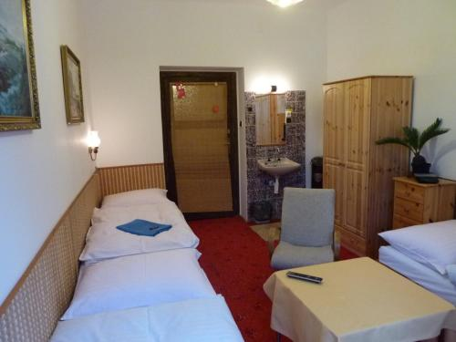 A bed or beds in a room at Pension 21