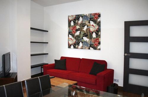 A seating area at Apartamentos Turísticos Sagasta