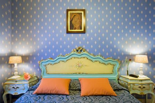 A bed or beds in a room at Hotel Villa San Lorenzo Maria